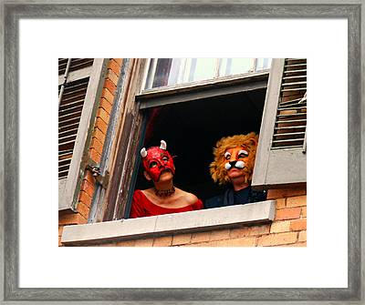 The Devil And The Lion Framed Print by Sherry Dooley
