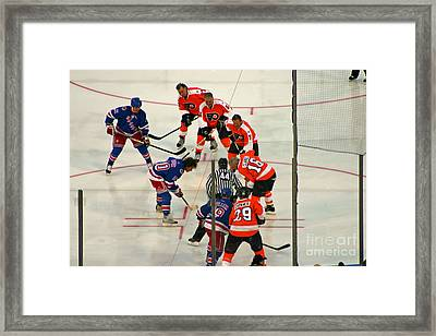 The Faceoff Framed Print by David Rucker