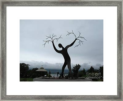 The Family Of Man Framed Print by Andre Paquin