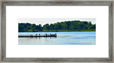 The Fishing Pier East Framed Print by Tina M Wenger