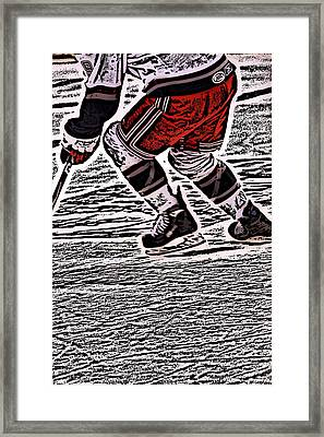 The Hockey Player Framed Print by Karol Livote