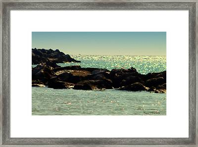 The Jetties Framed Print by Debra Forand