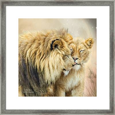 The Kiss Framed Print by Carol Cavalaris