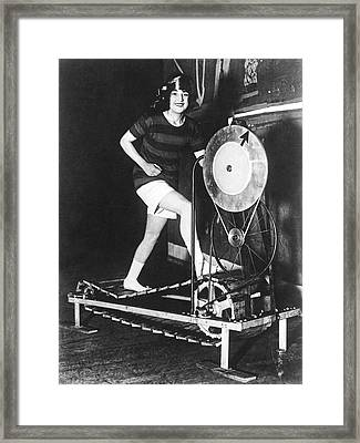 The Latest Exercise Machine Framed Print by Underwood Archives