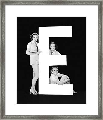 The Letter e And Three Women Framed Print by Underwood Archives