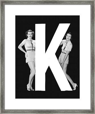 The Letter k  And Two Women Framed Print by Underwood Archives