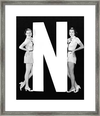 The Letter n  And Two Women Framed Print by Underwood Archives