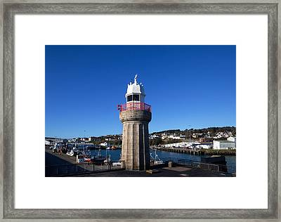The Lighthouse And Fishing Harbour Framed Print by Panoramic Images