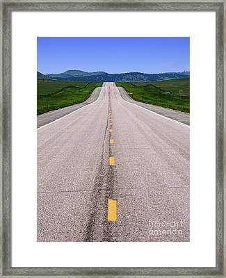 The Long Road Ahead Framed Print by Olivier Le Queinec