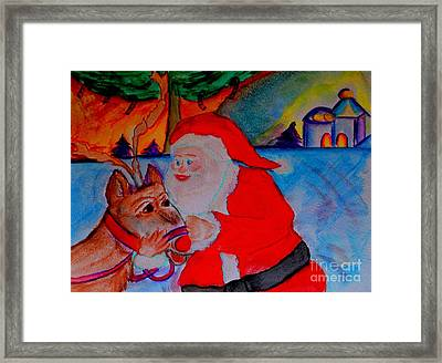 The Man In The Red Suit And A Red Nosed Reindeer Framed Print by Helena Bebirian