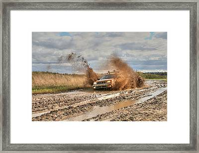 The Mud Is Flying Framed Print by Heather Allen