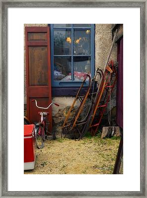 The Old Sleds Framed Print by Mary Machare