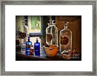 The Pharmacy Shelf Framed Print by Paul Ward