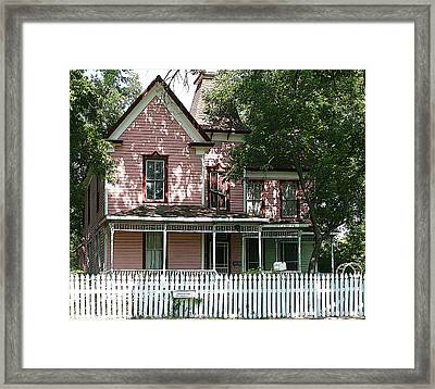 The Pink Victorian House Framed Print by Linda Phelps