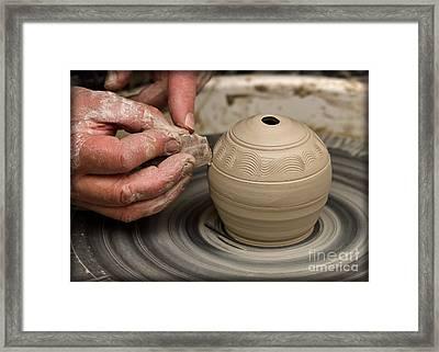 The Potter's Wheel Framed Print by Liz  Alderdice