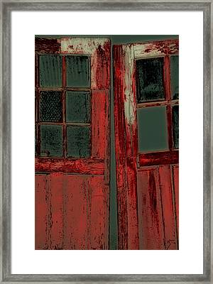 The Red Doors Framed Print by Karol Livote