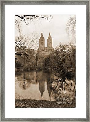 The San Remo Building Reflectec On The Lake In Central Park Vintage Look Framed Print by RicardMN Photography