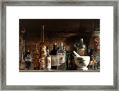 The Snake Oil Shop Framed Print by Olivier Le Queinec
