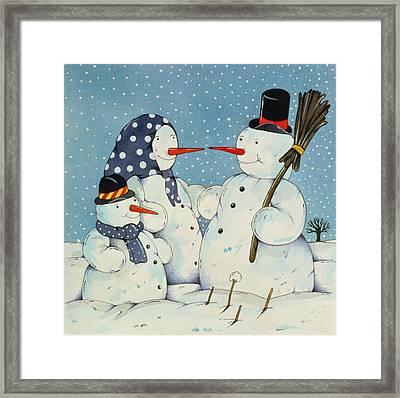 The Snowman Family Framed Print by Christian Kaempf