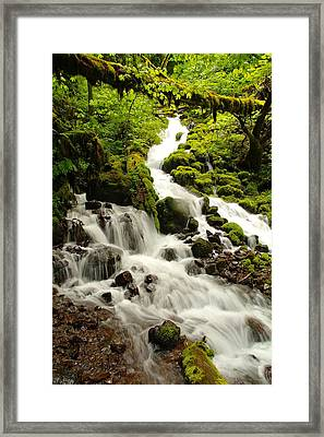 The Song Of Small Water Going Against The Rocks   Framed Print by Jeff Swan