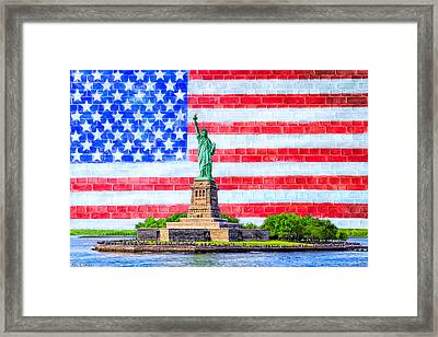 The Statue Of Liberty And The American Flag Framed Print by Mark E Tisdale