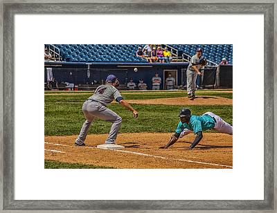 The Throw To First Framed Print by Karol Livote