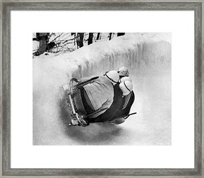 The Usa Bobsled Team On A Run Framed Print by Underwood Archives