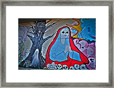The Virgin Skeleton Adoring Framed Print by Andres Leon