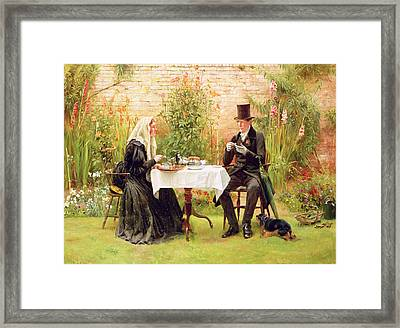 The Widow At Home Framed Print by Walter Dendy Sadler