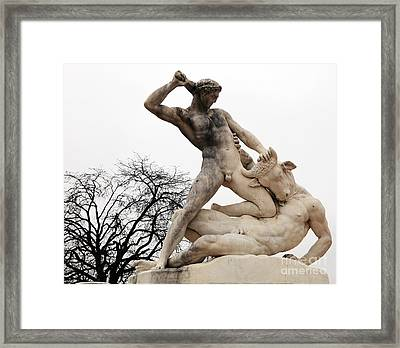 Theseus And The Minotaur Framed Print by John Rizzuto