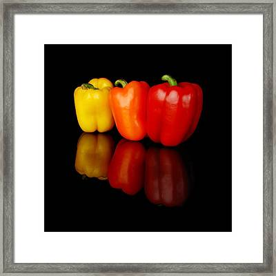 Three Bell Peppers Framed Print by Jim Hughes