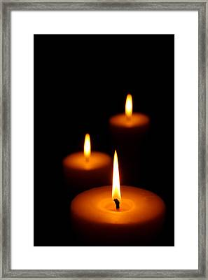 Three Burning Candles Framed Print by Johan Swanepoel