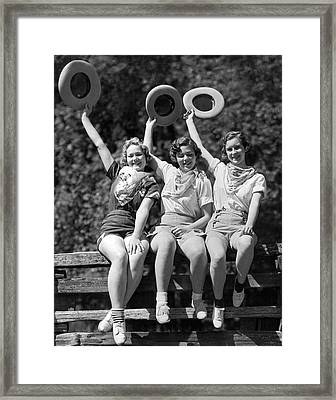 Three Cowgirls On A Fence Framed Print by Underwood Archives