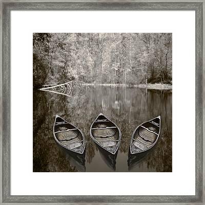 Three Old Canoes Framed Print by Debra and Dave Vanderlaan