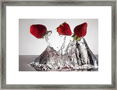 Three Strawberries Freshsplash Framed Print by Steve Gadomski