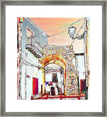 Through The Arch Framed Print by Loredana Messina