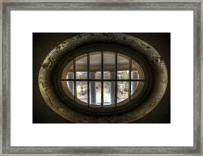 Through The Round Window Framed Print by Nathan Wright