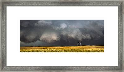 Thunderstorm Advancing Over A Field Framed Print by Panoramic Images