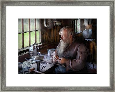 Tin Smith - Making Toys For Children Framed Print by Mike Savad