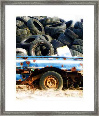 Tires Framed Print by Tom Romeo