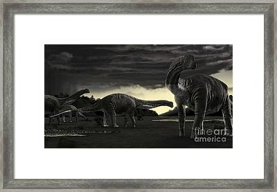 Titanosaurs In The First Storm Framed Print by Rodolfo Nogueira