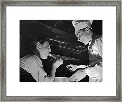 Tito Schipa Samples Dimaggio's Framed Print by Underwood Archives