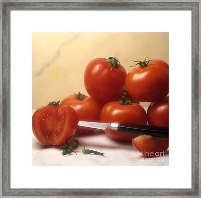 Tomatoes And A Knife Framed Print by Bernard Jaubert