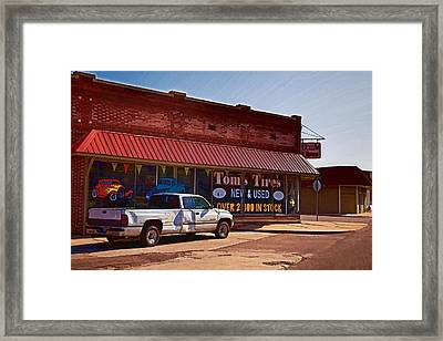 Tom's Tires Framed Print by Angie Rayfield