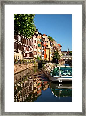 Tour Boat And Buildings Reflected Framed Print by Brian Jannsen