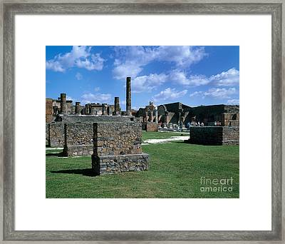 Tourists Amid Pompeii Ruins Framed Print by Rafael Macia
