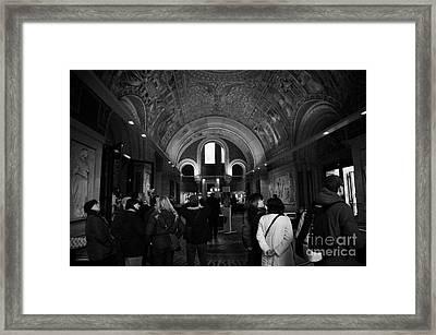 tourists inside the Gedenkhalle memorial hall of Kaiser Wilhelm Gednachtniskirche Framed Print by Joe Fox