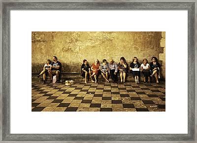Tourists On Bench - Taormina - Sicily Framed Print by Madeline Ellis