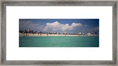 Tourists On The Beach, Miami, Florida Framed Print by Panoramic Images
