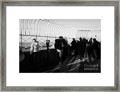 Tourists On The View From Observation Deck  Empire State Building New York City Usa Framed Print by Joe Fox